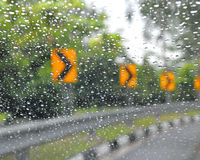 Traffic road signs on a rainy day Stock Photo