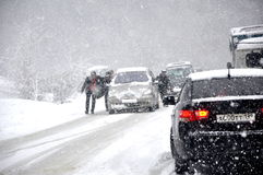 Traffic on the road in the snow Royalty Free Stock Photo