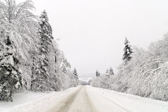 Traffic road in snow Royalty Free Stock Images