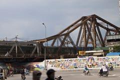 Traffic on a road under railway bridge Royalty Free Stock Photography