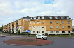 A Traffic Roundabout and Modern Apartments in Bracknell, England Royalty Free Stock Photo
