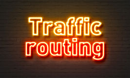 Traffic routing neon sign on brick wall background. Stock Photos