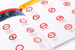 Traffic rules. Study book opened page with road signs Royalty Free Stock Images