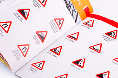 Traffic rules. Study book opened page with road signs Royalty Free Stock Image