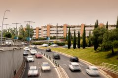 Traffic rush hour with a blurred train in the background stock photography