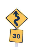 Traffic S-Curves Sign. A Traffic sign warns of sharp turns ahead and speed limit on a road stock photos