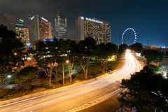 Light trails and cityscape in Singapore at dusk stock image