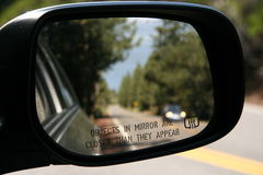 Traffic safety. Watching traffic in the car mirror Stock Photography