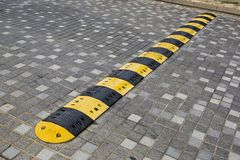 Traffic safety speed bump on an asphalt road Royalty Free Stock Photography