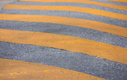 Traffic safety speed bump on the road Stock Photography