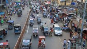 Traffic at Saheb Bazar Road in Rajshahi, Bangladesh. RAJSHAHI, BANGLADESH - NOVEMBER 9, 2016: Traffic at Saheb Bazar Road in Rajshahi, Bangladesh stock footage