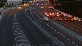 Traffic scene  at dusk. Long Exposure.Time Lapse. Traffic at dusk in a main street of entry and exit of Barcelona, As it gets dark. Top view. Long Exposure. Time stock video footage