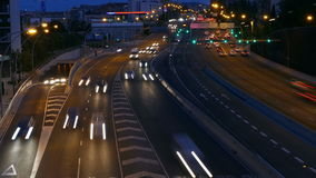 Traffic scene at dusk. Long exposure. Time lapse. Traffic at dusk in a main street of entry and exit of Barcelona, As it gets dark. Top view. Long Exposure. Time stock video
