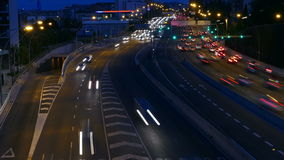 Traffic scene  at dusk. Long Exposure.Time Lapse. Traffic at dusk in a main street of entry and exit of Barcelona. Top view. Long Exposure. Time Lapse stock footage