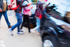 Traffic scene with pedestrians and car in motion blur Royalty Free Stock Photos