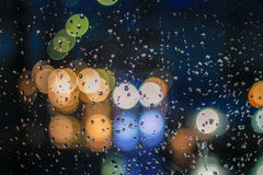Traffic scene from a wet cristal window Stock Photo