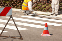 Traffic Series: Renew the Road Marking on the Street. Real Workers Renew the Road Marking on the Street Royalty Free Stock Photography