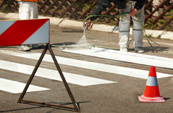 Traffic Series: Renew the Road Marking on the Street. Real Workers Renew the Road Marking on the Street Stock Photography