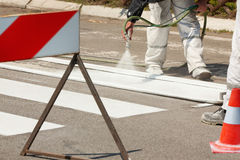 Traffic Series: Renew the Road Marking on the Street. Real Workers Renew the Road Marking on the Street Stock Images