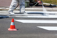 Traffic Series: Renew the Road Marking on the Street Stock Photos