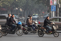 Traffic in Shanghai. Lots of people are using electric scooters. Photo taken at 20th of November 2010 Royalty Free Stock Photo