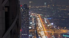 Dubai Downtown night timelapse modern towers panoramic view from the top in Dubai, United Arab Emirates. Traffic on the Sheikh Zayed road near business bay stock footage