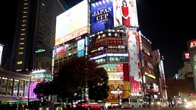 Traffic on the Shibuya intersection. JAPAN, TOKYO, NOV 22 2016, Traffic on the Shibuya intersection at night in Tokyo, Japan stock footage