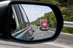 Traffic In Side View Mirror Stock Images