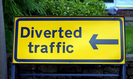 Traffic sign. Sign diverting traffic in yellow and blue Royalty Free Stock Photography