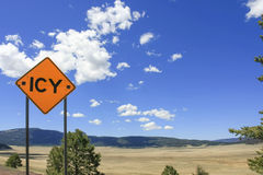 Traffic sign. ICY in summer landscape Royalty Free Stock Photo