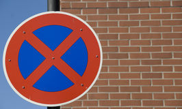 Traffic sign. Against a brick wall stock photography