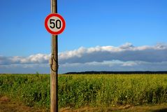 Traffic sign: Only 50. Traffic sign, showing that only 50 is allowed. Sunny day, blue sky. Image with copy space royalty free stock photos