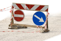 Traffic sign. The detour pointer. Red ribbons. A rough wooden frame Stock Images
