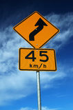 Traffic Sign. Curved Road Traffic Sign over Blue Sky royalty free stock images