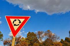 Traffic sign against blue sky with clouds Stock Photography