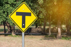 Traffic sign alert for crossroad ahead Stock Photos