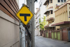 Traffic sign alert for crossroad ahead. Royalty Free Stock Photo