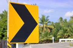 Traffic sign alerts turn right curve of the road. Yellow traffic sigh royalty free stock images
