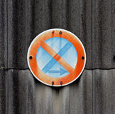 Traffic sign on a asbestos wall Royalty Free Stock Photo
