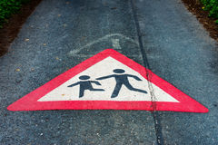 Traffic sign Attention children playing on the floor of a street. The Traffic sign Attention children playing on the floor of a street Royalty Free Stock Photo