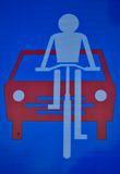 Traffic sign, biker and red car Stock Photo