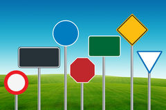 Traffic sign on blue sky and green grass Stock Image
