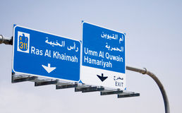 Traffic Sign Board on Emirates Road. English and Arabic Sign board in Dubai emirates road Royalty Free Stock Photo