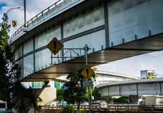 A traffic sign board and tree under highway fly over photo taken in Jakarta Indonesia Royalty Free Stock Images