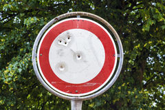 Traffic sign with bullet holes Stock Photos