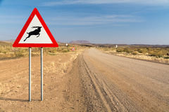 Traffic Sign: Caution Springbok crossing road Stock Photography