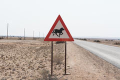 Traffic Sign: Caution wild horse crossing road Stock Image