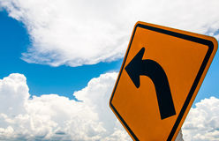 Traffic sign and clouds. In the blue sky Royalty Free Stock Images