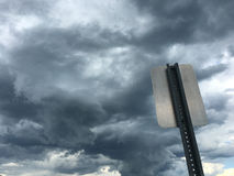 Traffic sign on cloudy sky Royalty Free Stock Photo