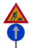 Traffic sign for construction works in street and blue direction Royalty Free Stock Photos